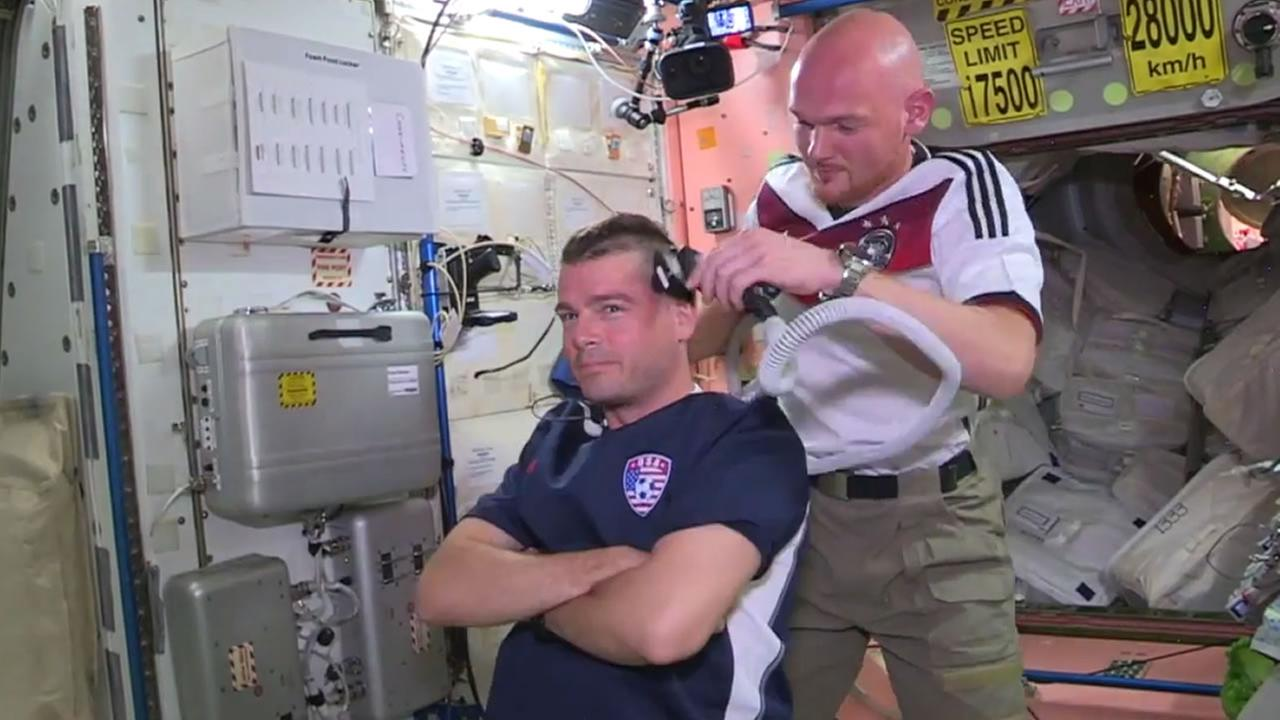American astronauts Reid Wiseman and Steve Swanson had their heads shaved after the U.S. fell to Germany in the World Cup Thursday.