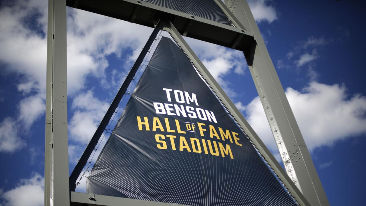 These are signs hanging at Tom Benson Hall of Fame Stadium before the Pro Football Hall of Fame induction ceremony Saturday, Aug. 6, 2016, in Canton, Ohio.