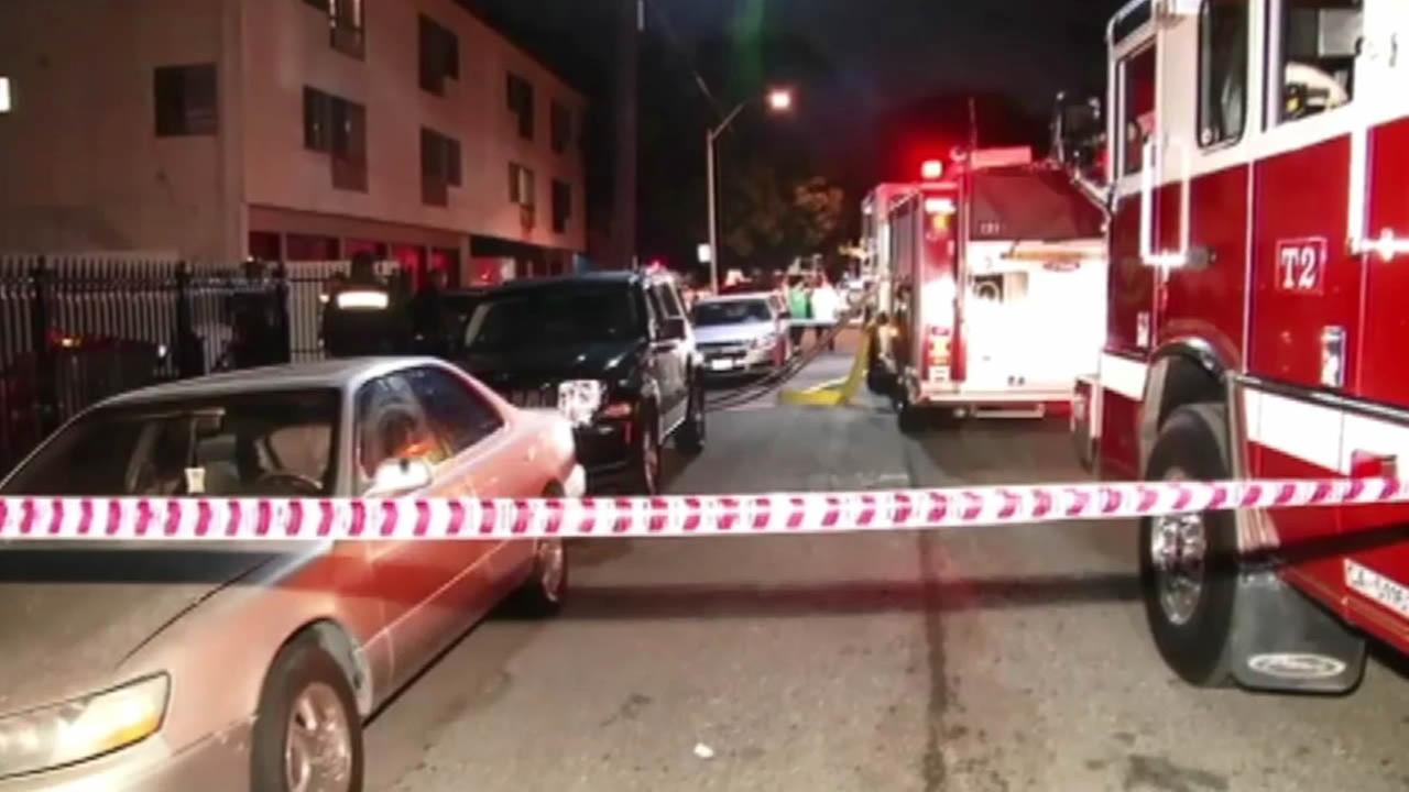 Police are searching for two people in connection to a fire that caused an explosion at an Oakland apartment building Friday night