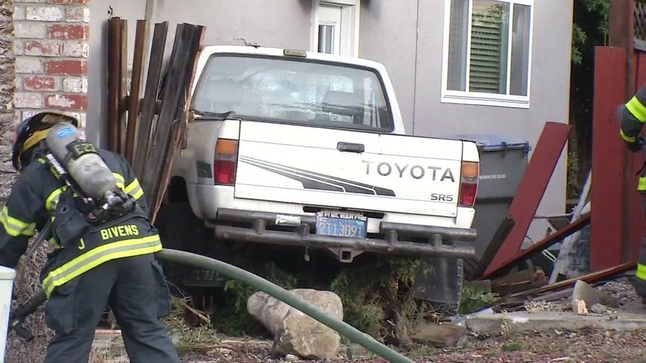 Truck crashes into home in San Jose, California, Monday, August 8, 2016.