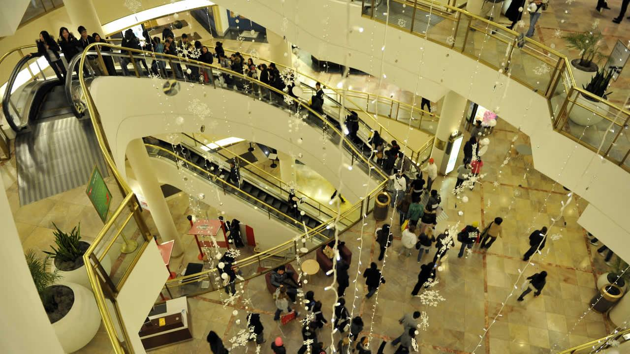 Early morning holiday shoppers ride the escalators in the Westfield Centre in San Francisco, Friday, Nov. 27, 2009.