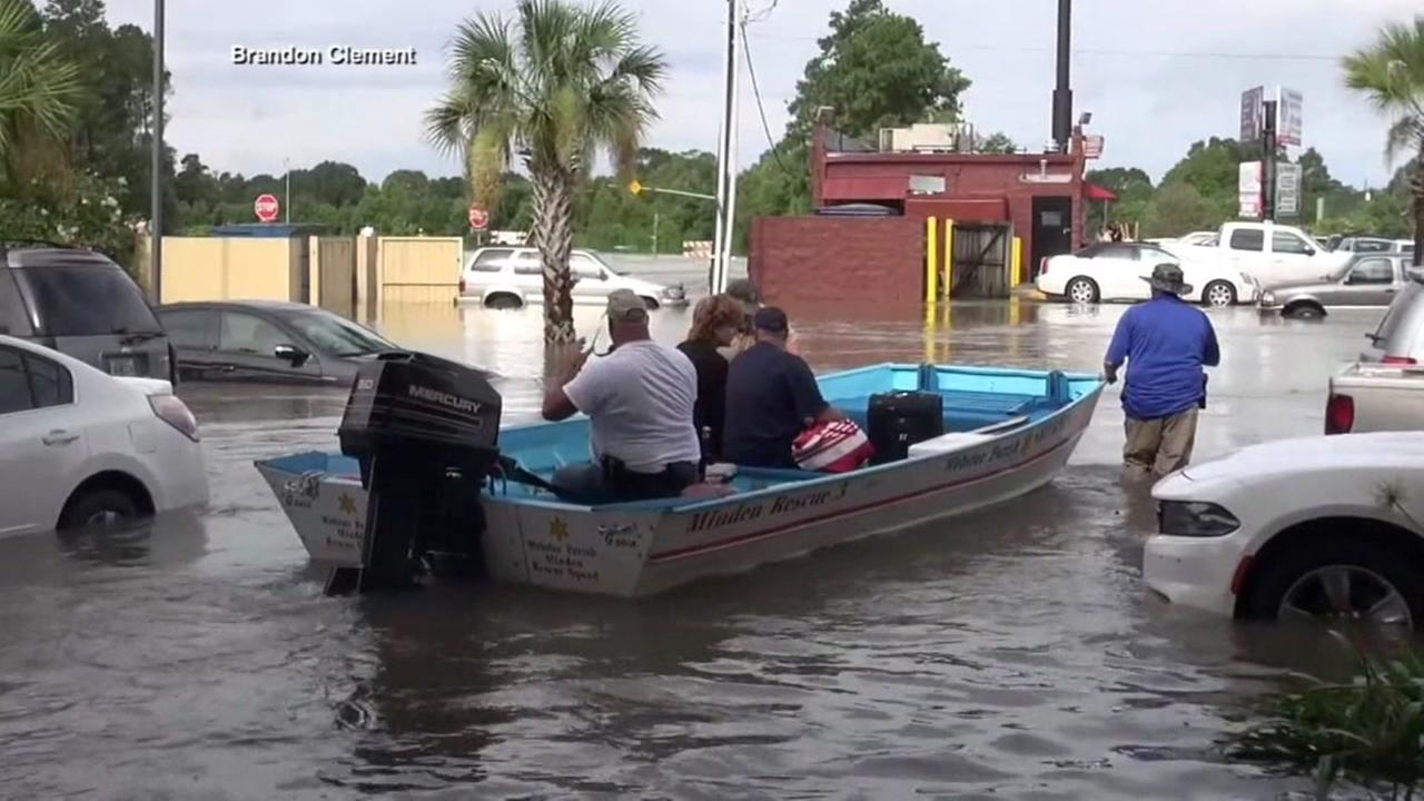 Boat goes through flooding in Louisiana, Sunday, August 15, 2016.
