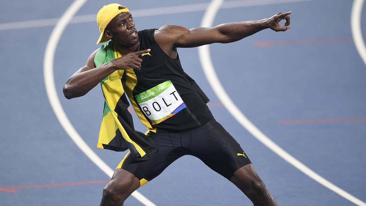 Jamaicas Usain Bolt celebrates winning the mens 100-meter final during the athletics competitions of the 2016 Summer Olympics at the Olympic stadium in Rio de Janeiro, Brazil, Sunday, Aug. 14, 2016. (AP Photo/Martin Meissner)