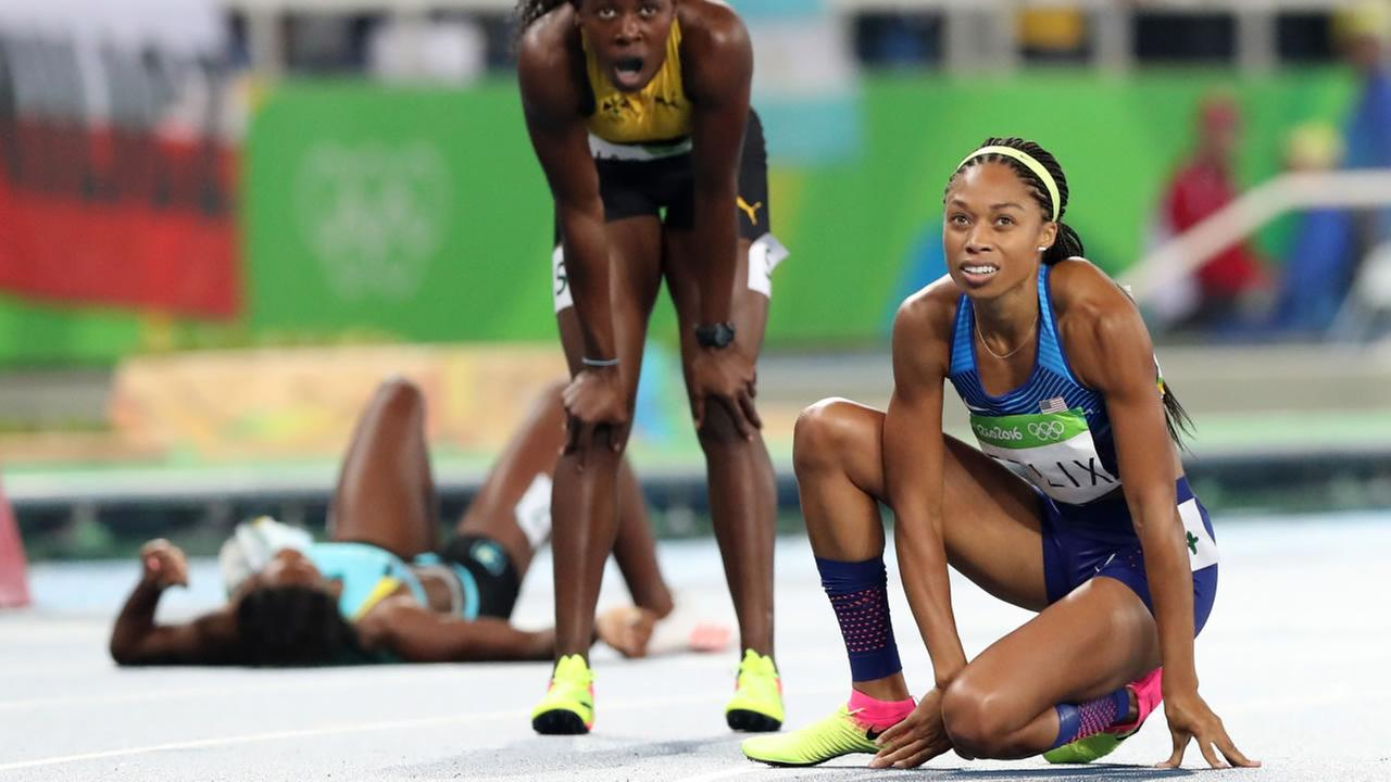 United States Allyson Felix, right, looks at the scoreboard after the womens 400-meter final during the athletics competitions of the 2016 Summer Olympics at the Olympic stadium in Rio de Janeiro, Brazil, Monday, Aug. 15, 2016.