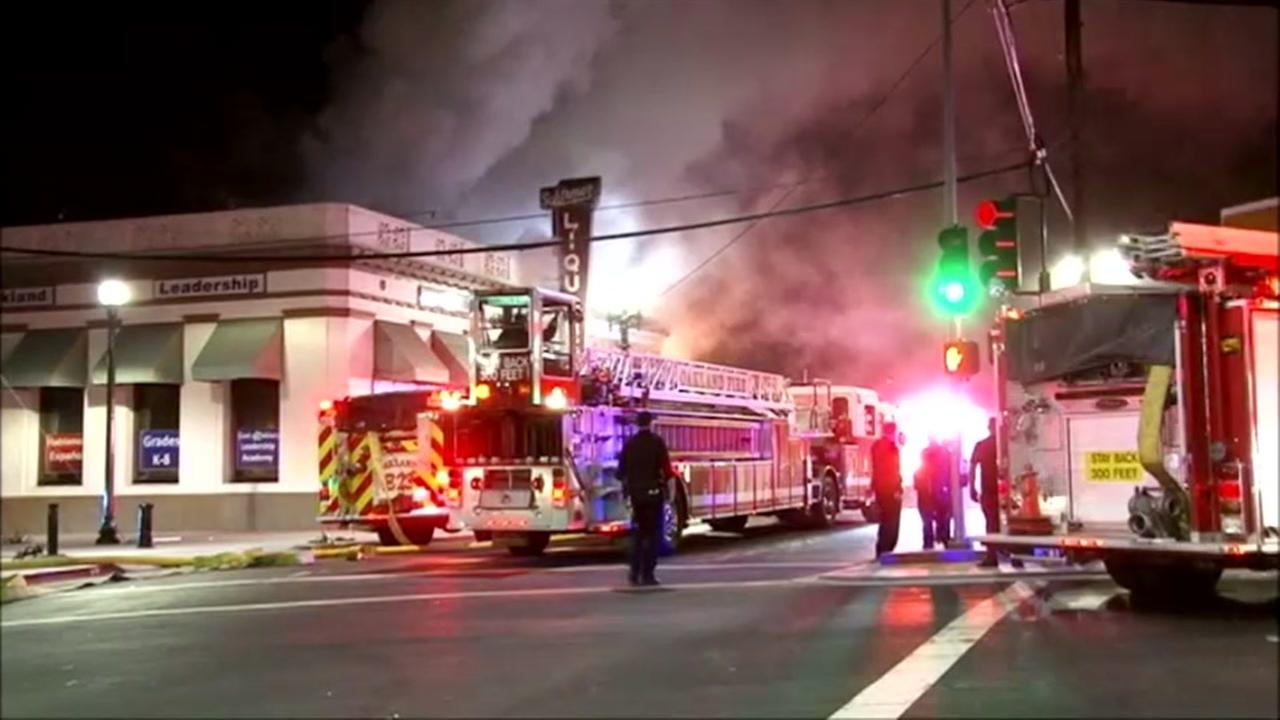 This image shows Oakland firefighters battling a blaze at liquor store on August 16, 2016.