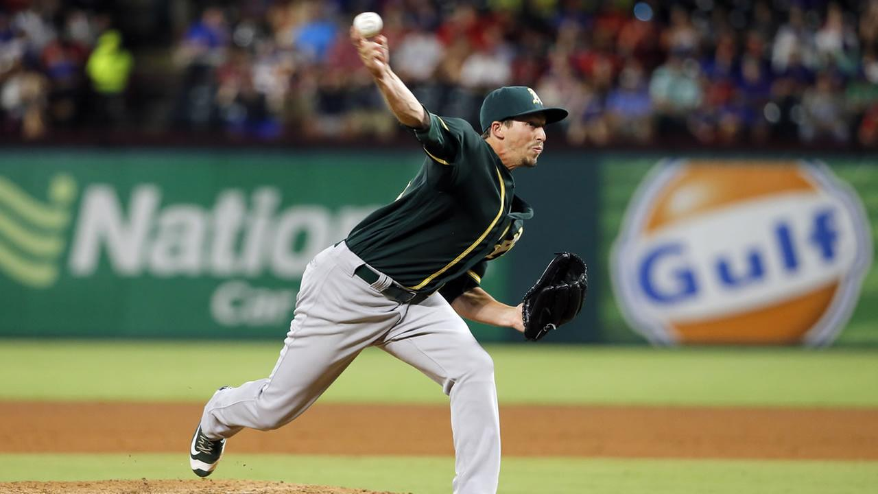Oakland Athletics relief pitcher Ryan Dull throws to the Texas Rangers in the sixth inning of a baseball game, Tuesday, Aug. 16, 2016, in Arlington, Texas.