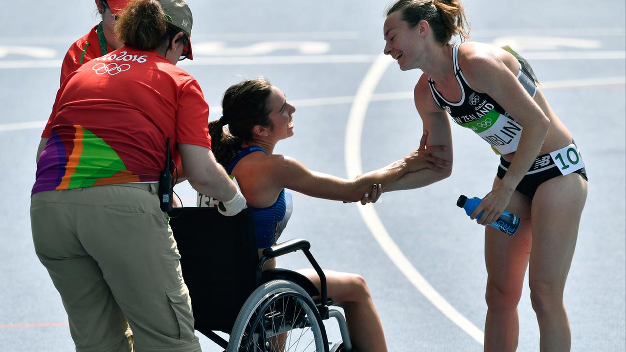 New Zealands Nikki Hamblin greets United States Abbey DAgostino, left, as she is helped from the track after competing in the Olympics in Brazil, Tuesday, August 15, 2016.