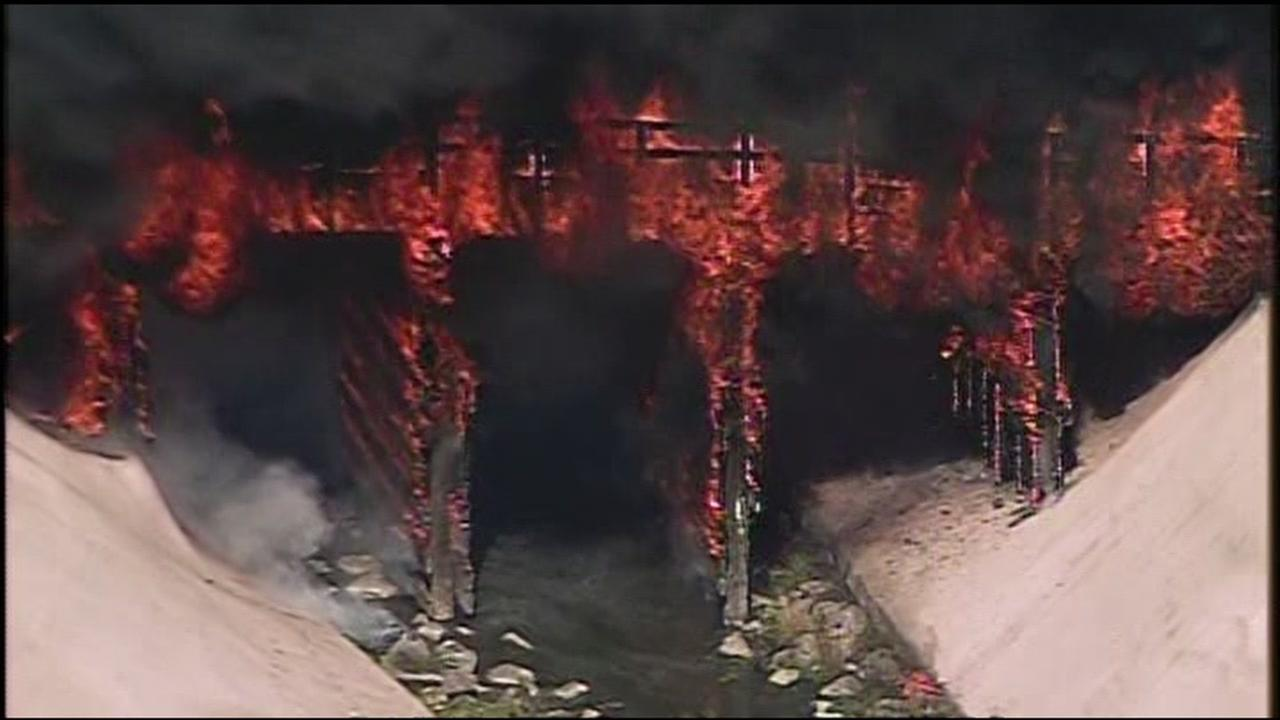 Thick, black smoke is seen after a railroad trestle caught fire near Highway 101 in San Jose, Calif. on Wednesday, August 17, 2016.KGO-TV