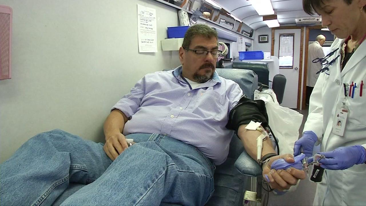 KGO-TV employee Ron Lopez donates blood during the ABC7 blood drive in San Francisco on Thursday, August 17, 2016.