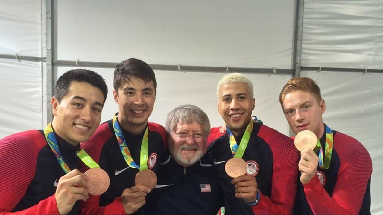 The image shows Matthew Porter (center) with the bronze-medal-winning U.S. mens fencing team.
