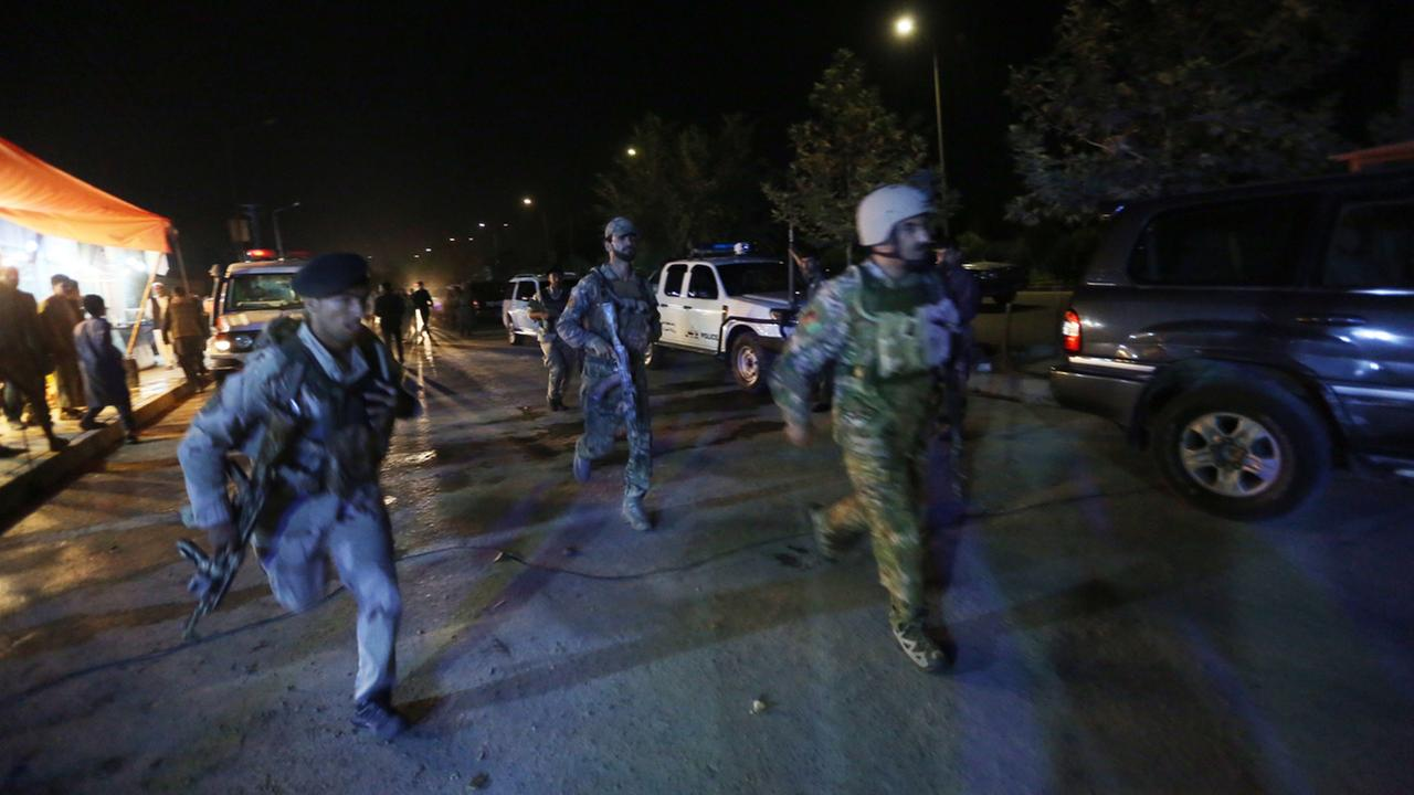 Afghan security forces rush to respond to a complex Taliban attack on the campus of the American University in the Afghan capital Kabul on Wednesday, Aug. 24, 2016.