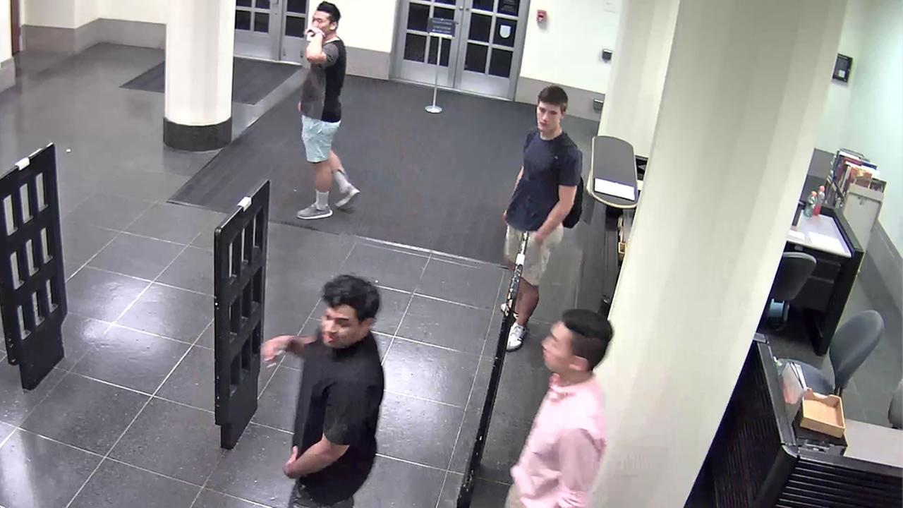 This image from surveillance video shows four people who UC Berkeley police believe vandalized the Doe Library in Berkeley, Calif. on Thursday, June 23rd, 2016.