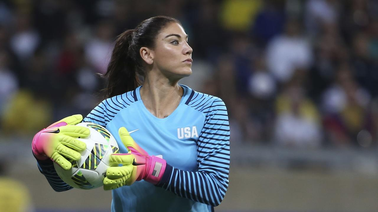 FILE - In this Aug. 3, 2016, file photo, U.S. goalkeeper Hope Solo takes the ball during a womens Olympic football tournament match against New Zealand in Belo Horizonte, Brazil.