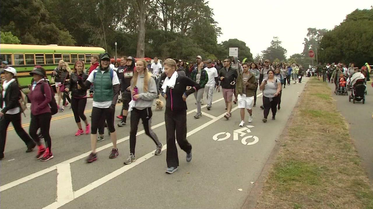 This image shows people walking in Golden Gate Park for the 2016 San Francisco AIDS Walk.