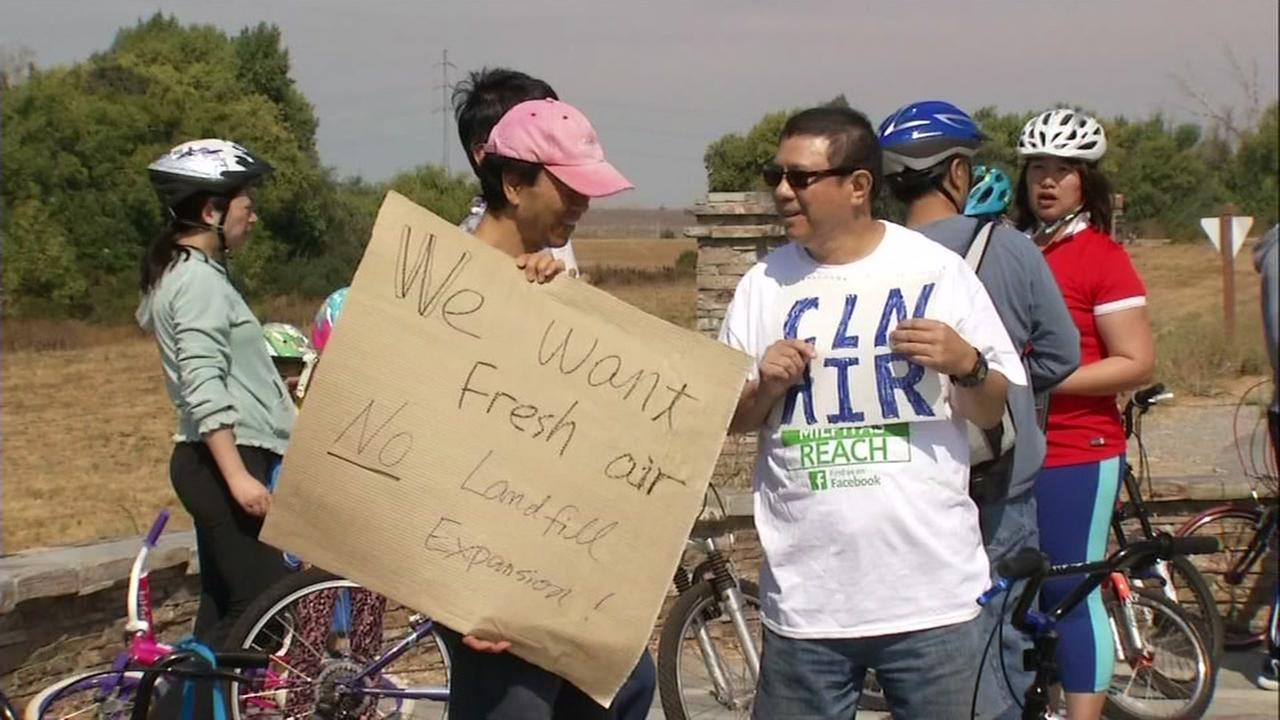This image shows Milpitas residents protesting the proposed expansion of the Newby Island Landfill in Milpitas, Calif. on August