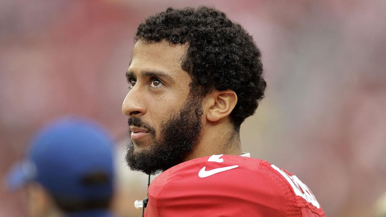 In this Nov. 8, 2015, file photo, San Francisco 49ers quarterback Colin Kaepernick stands on the field during a game against the Atlanta Falcons in Santa Clara, Calif.