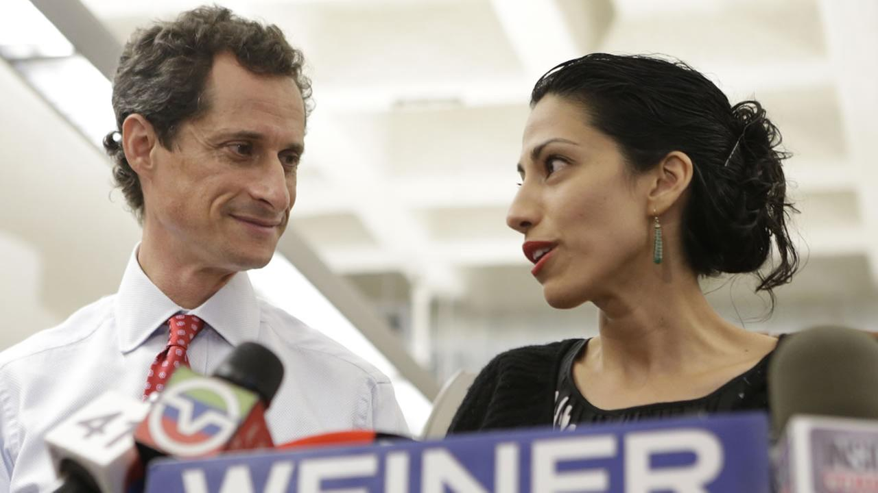 In this July 23, 2013 file photo, Huma Abedin, alongside her husband, Anthony Weiner, speaks during a news conference in New York.