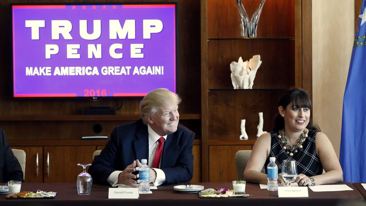 Republican presidential candidate Donald Trump leads a Hispanic leaders and small business owners roundtable in Las Vegas, Friday, Aug. 26, 2016. Right is Irma Aguirre, a local business owner.