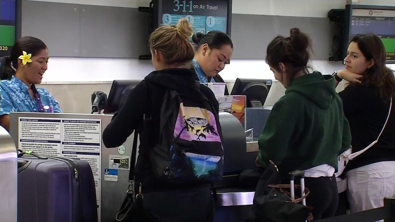 Travelers check in for their flights at the Hawaiian Airlines counter at the Oakland International Airport on Wednesday, August 31, 2016.