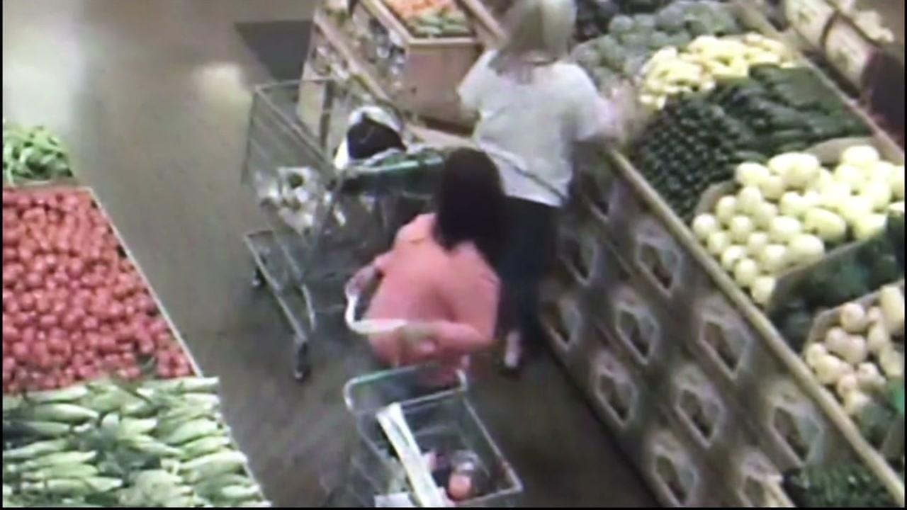 This image from surveillance video in Roseville, Calif. on Aug. 26, 2016 shows two women in a grocery store before a brazen purse theft.