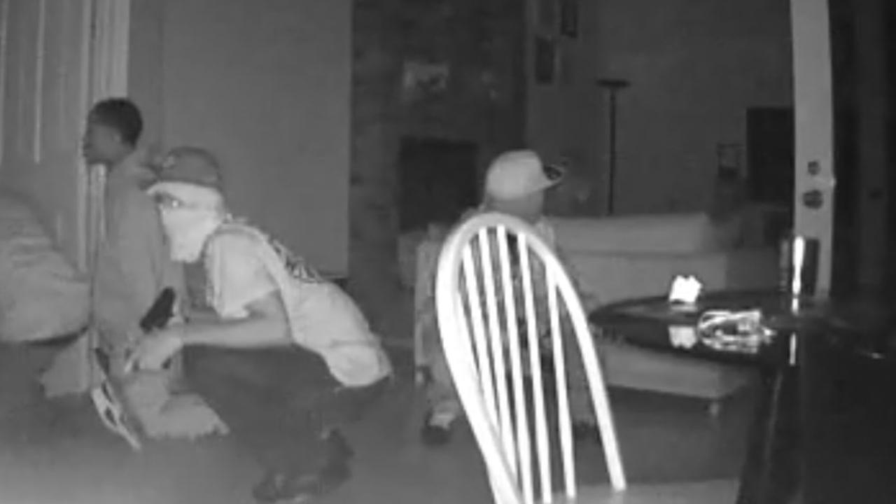 This image is taken from surveillance video that shows a home invasion robbery in progress in Fremont, Calif.