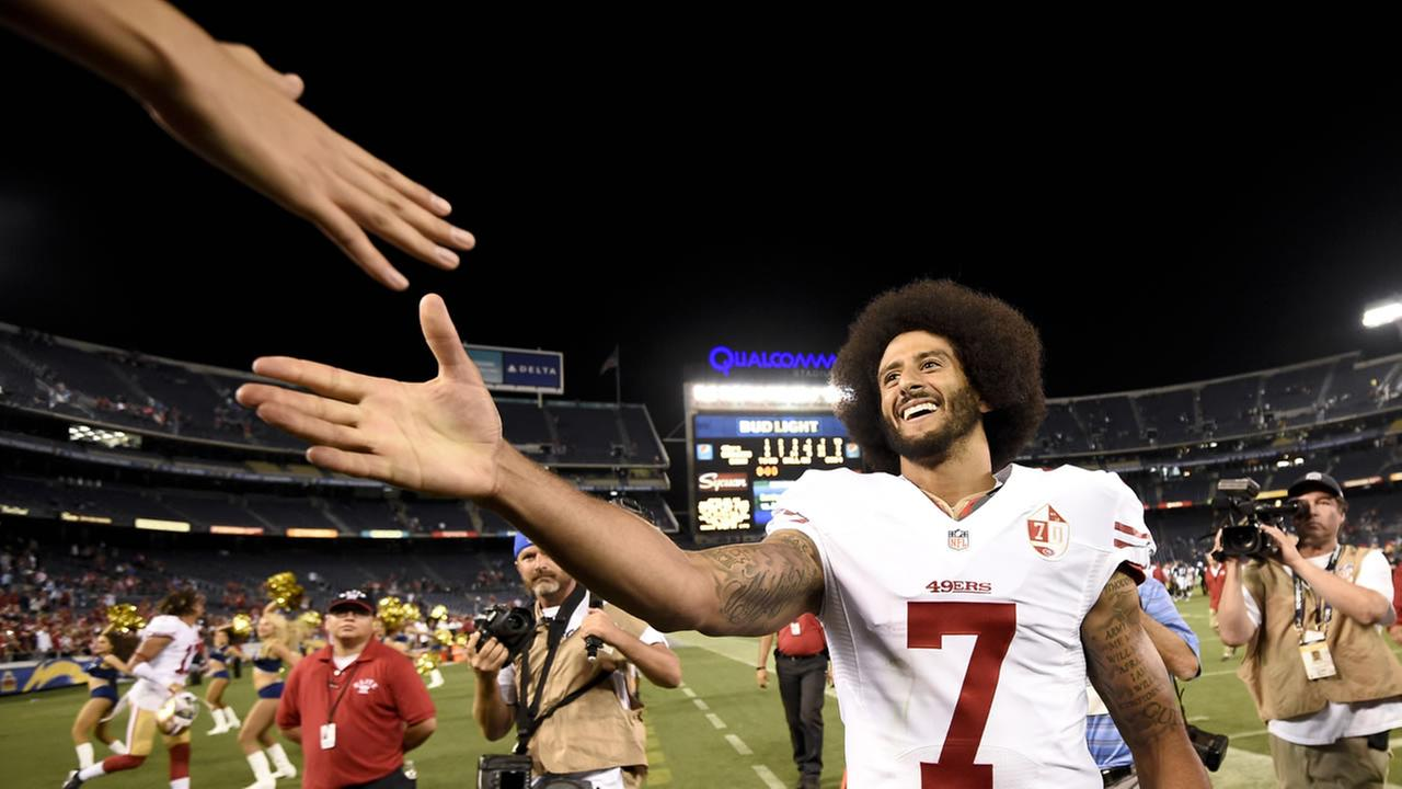 San Francisco 49ers quarterback Colin Kaepernick shakes hands with fans after the 49ers defeated the San Diego Chargers 31-21 during an NFL preseason football game.