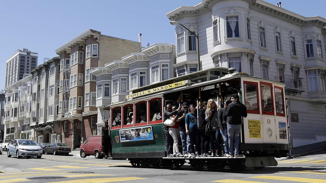 Visitors ride the Powell and Market cable car line in San Francisco, Thursday, May 30, 2013. (AP Photo/Marcio Jose Sanchez)