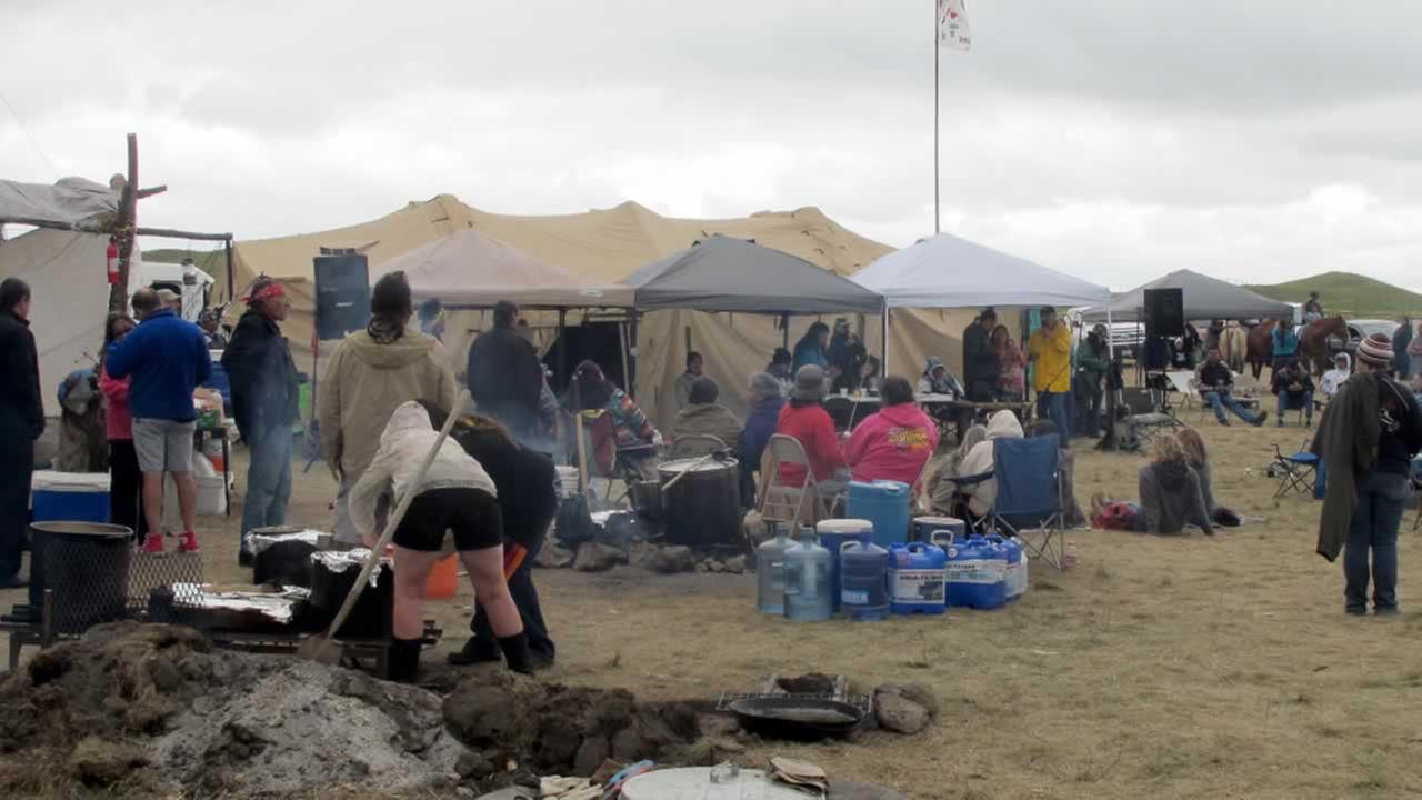 People protesting the construction on a four-state oil pipeline at a site in North Dakota gather at campground near the Standing Rock Sioux reservation on Thursday, Aug. 25, 2016.