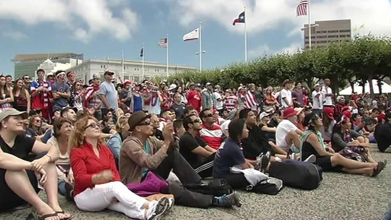 Fans watch the World Cup match between Belgium and Team USA at San Franciscos Civic Center Plaza.