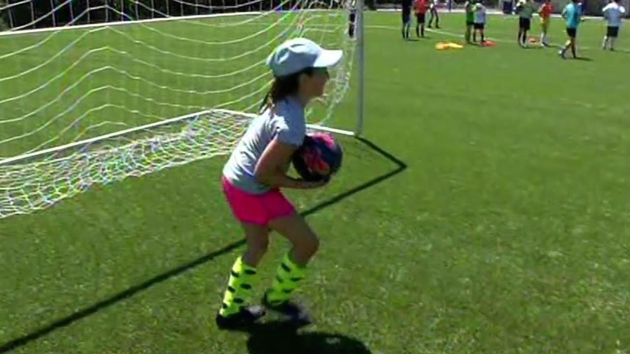 Tessa Rodriguez, 9, practices at a soccer camp in Los Gatos.
