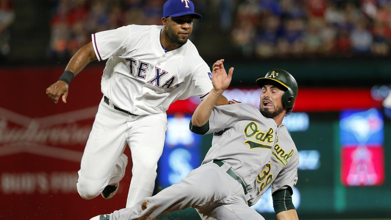 Texas Rangers shortstop Elvis Andrus, left, tags out Oakland Athletics Brett Eibner as Eibner was trying to steal second in the fourth inning of a baseball game, Friday, Sept. 16, 2016, in Arlington, Texas. (AP Photo/Tony Gutierrez)