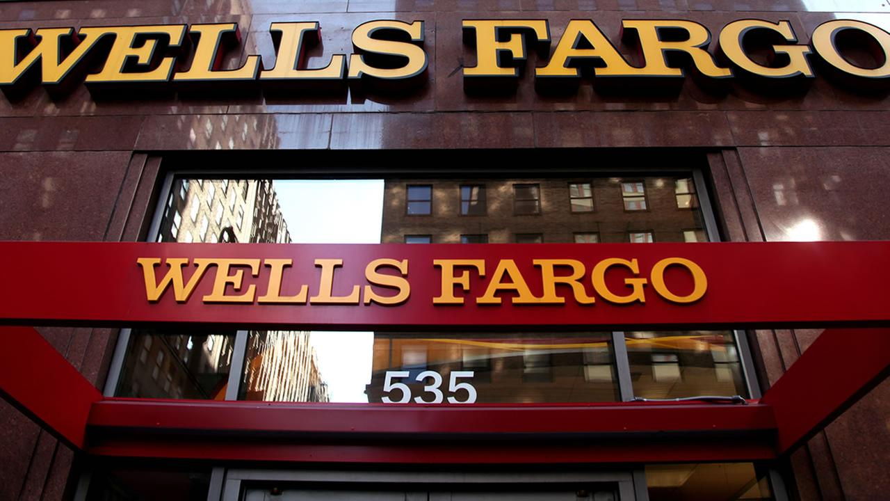 In this May 6, 2012, file photo, a Wells Fargo sign is displayed at a branch in New York. (AP Photo/CX Matiash, File)