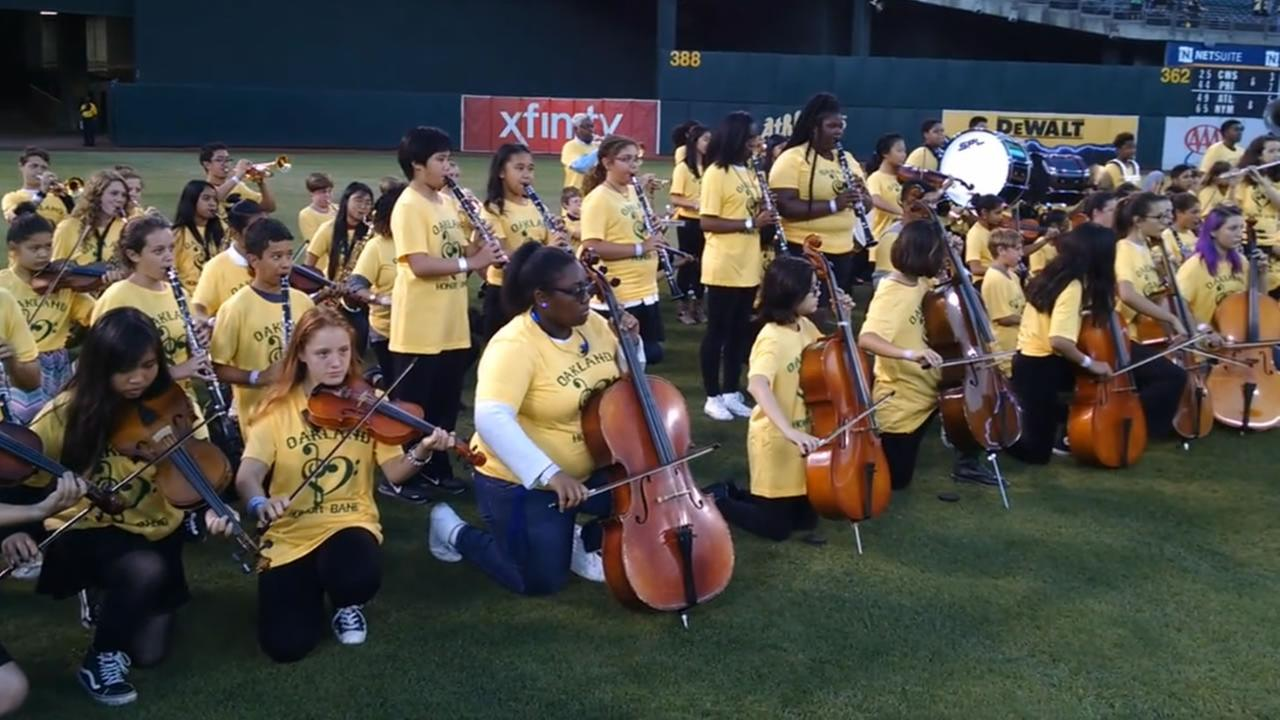 Members of the Oakland Unified School District Honor Band took a knee while playing the national anthem before an Athletics game in Oakland, Calif. on September 20, 2016.