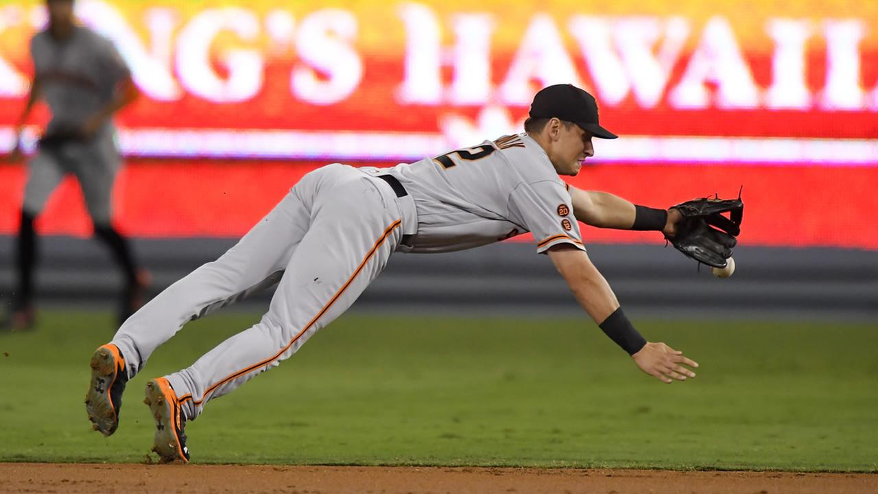 San Francisco Giants second baseman Joe Panik cant reach a ball hit for a single by Los Angeles Dodgers Howie Kendrick during the first inning of a baseball game, Sept. 21, 2016.
