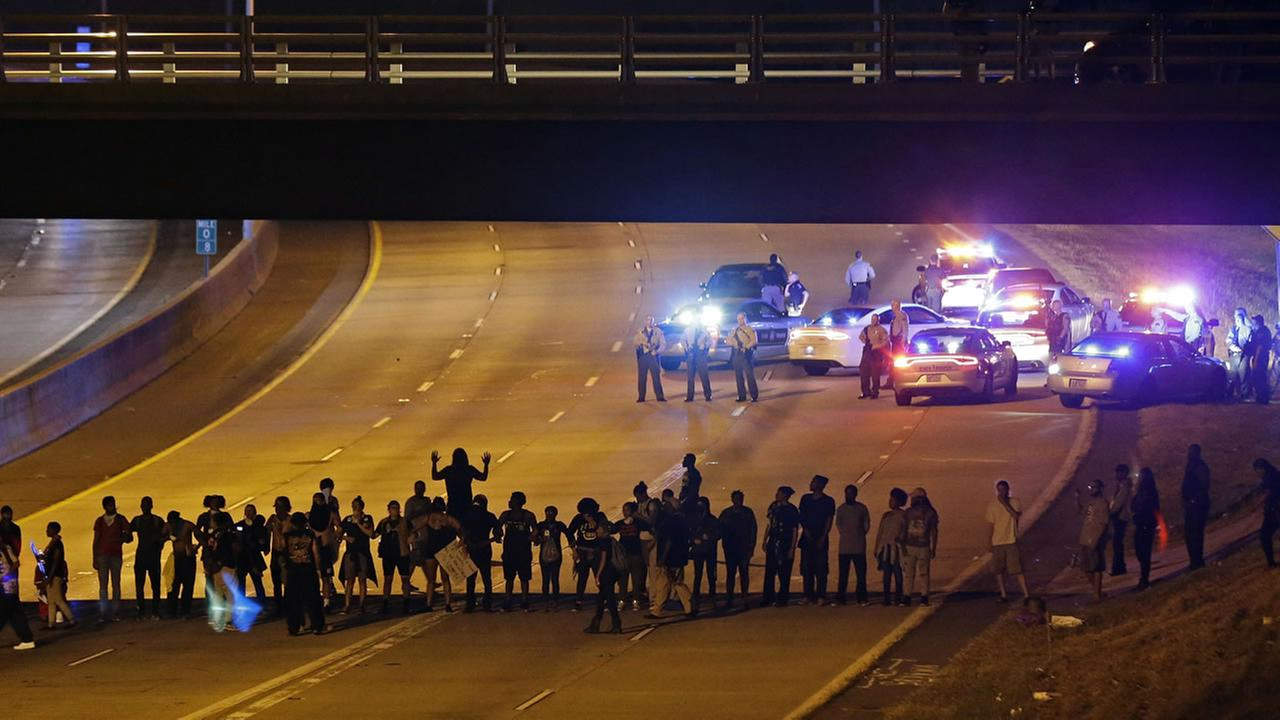 Police confront protesters blocking I-277 during demonstrations following Tuesdays police shooting of Keith Lamont Scott in Charlotte, N.C., Thursday, Sept. 22, 2016.