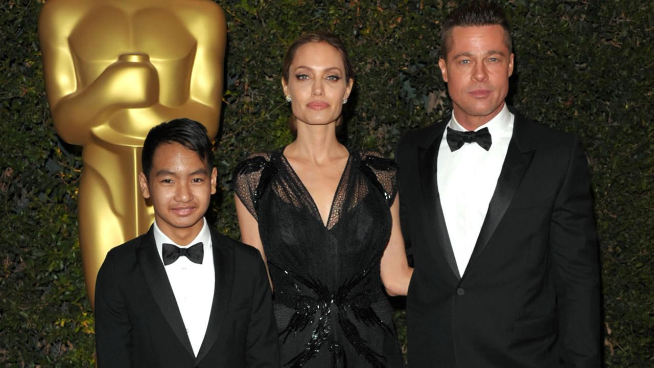 In this Nov. 16, 2013 file photo, Maddox Jolie-Pitt, from left, Angelina Jolie and Brad Pitt attend the 2013 Governors Awards in Los Angeles.