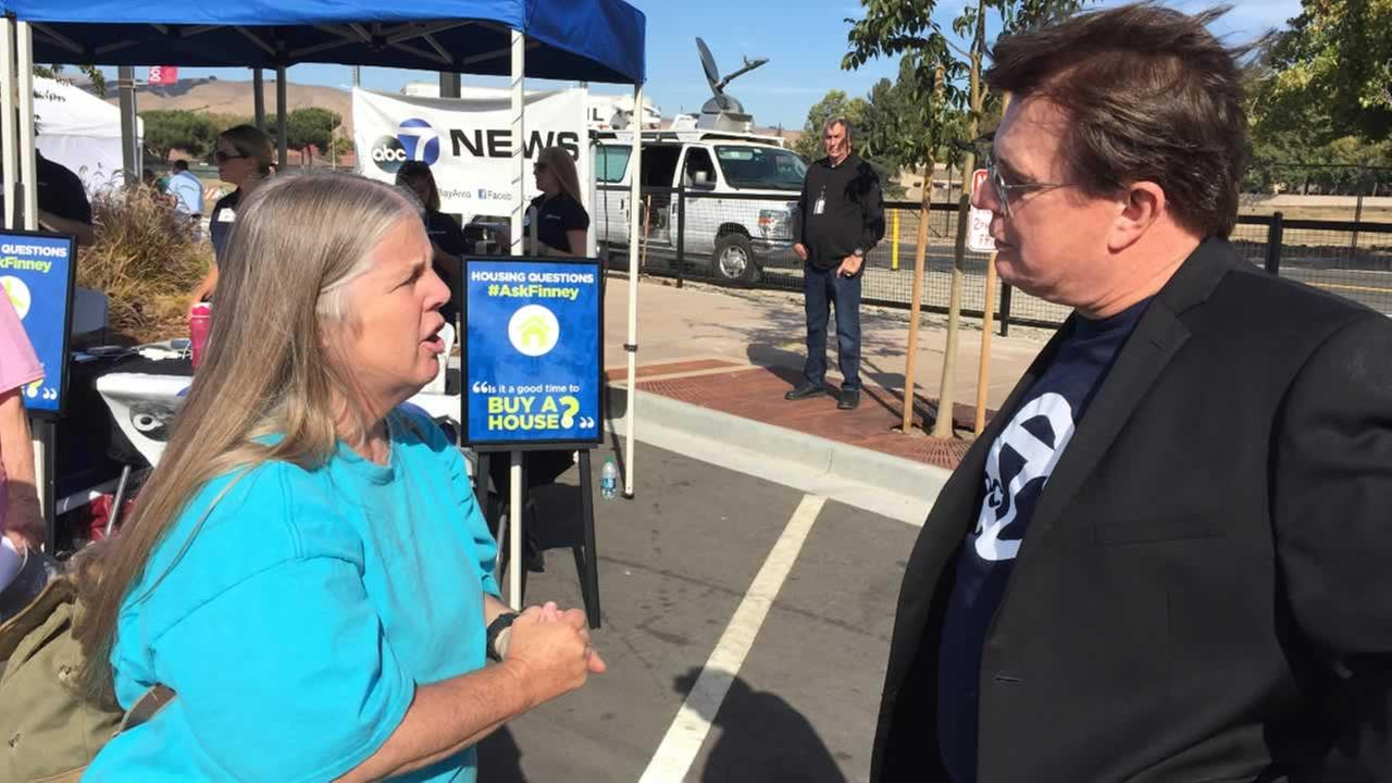 Cheryl gets help from Michael Finney at Fremont Street Eats in Fremont Calif. on Friday, September 23, 2016.