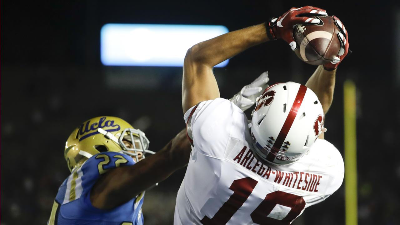Stanford wide receiver JJ Arcega-Whiteside, right, catches the game winning touchdown under pressure from UCLA defensive back Nate Meadors during n NCAA college football game.