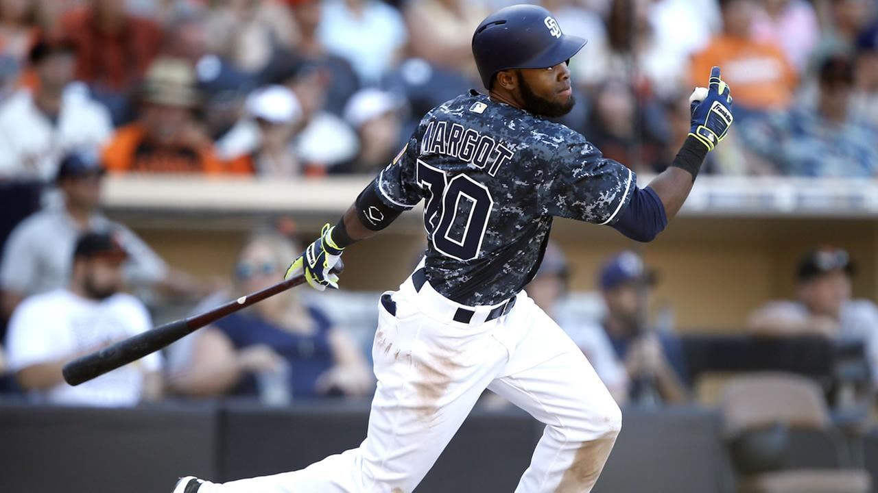 San Diego Padres Manuel Margot hits a triple against the San Francisco Giants during the seventh inning of a baseball game in San Diego, Sunday, Sept. 25, 2016. (AP Photo)