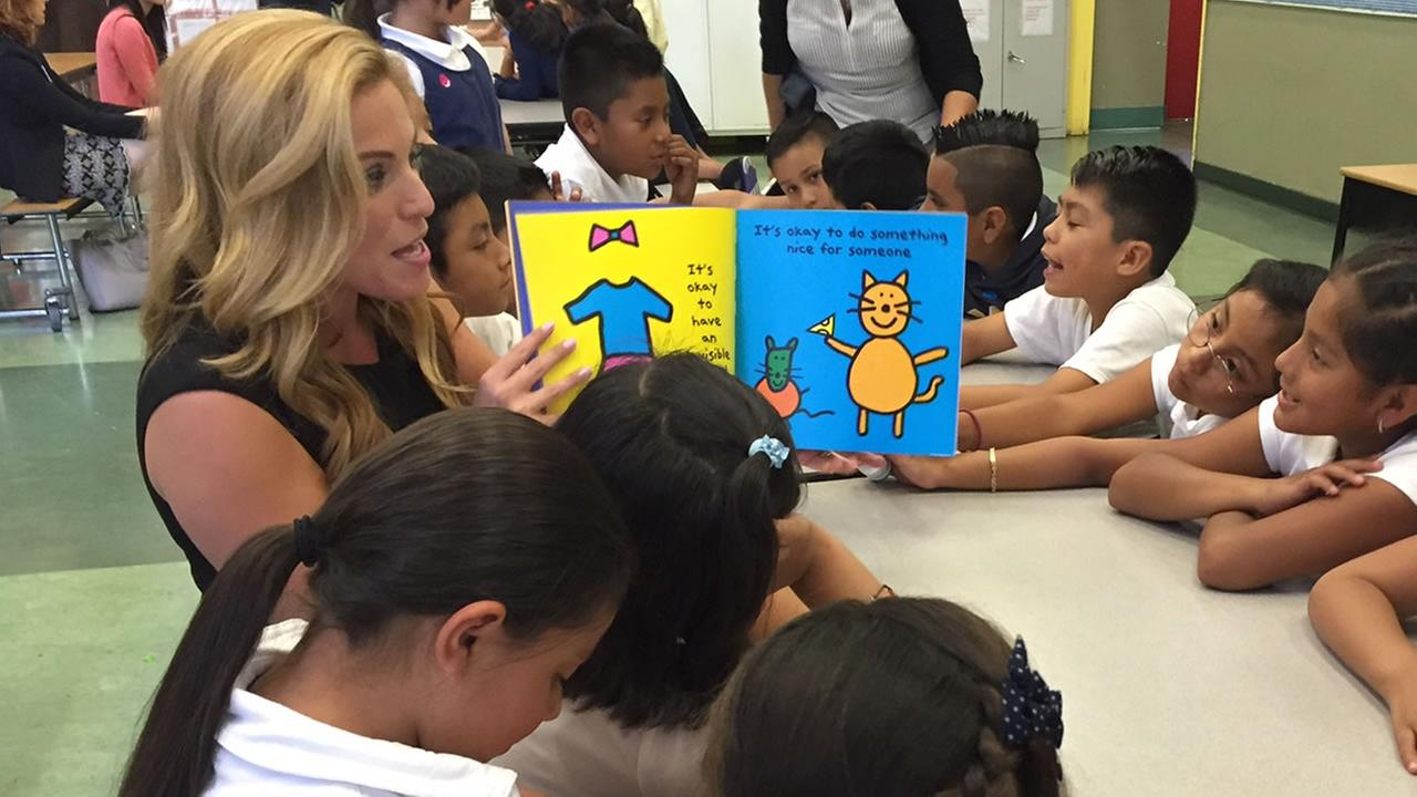 ABC7 News traffic reporter Alexis Smith reads to a group of second and third graders at Bryant Elementary School in San Francisco on Tuesday, September 27, 2016.