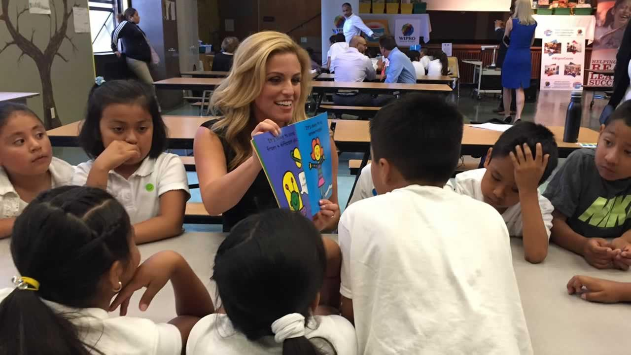ABC7 News traffic reporter Alexis Smith reads to a group of second and third graders at Bryant Elementary School in San Francisco on Tuesday, September 27, 2016.KGO-TV