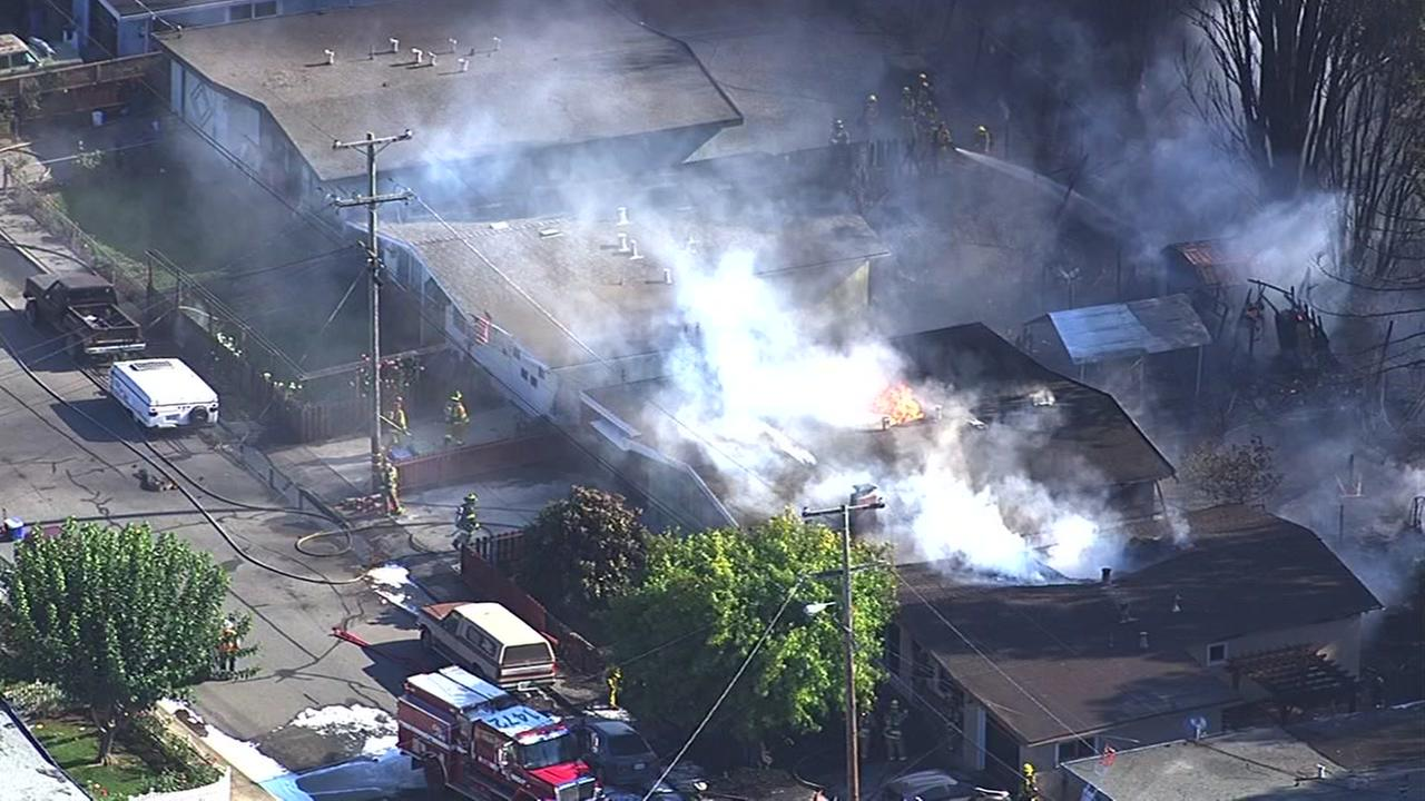 A fire in Petaluma is burning multiple homes near Lakeville Highway and northbound Highway 101 on Sept. 27, 2016.KGO-TV