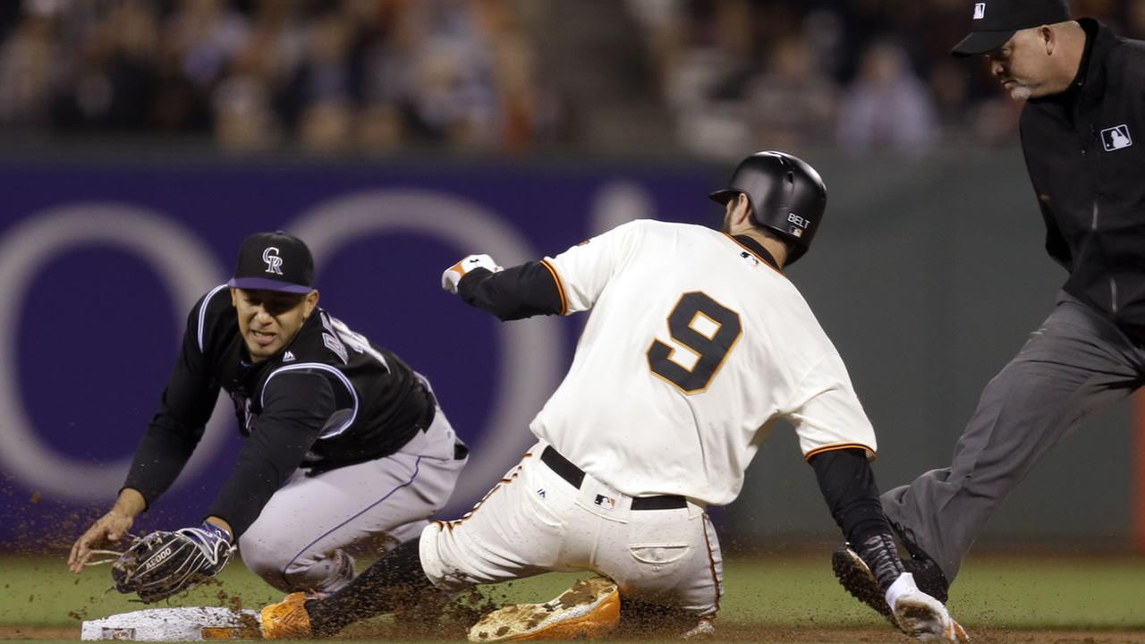 Giants Belt beats the tag of Rockies Adames as he slides with a double in the first inning of a baseball game, Tuesday, Sept. 27, 2016, in San Francisco. (AP Photo)