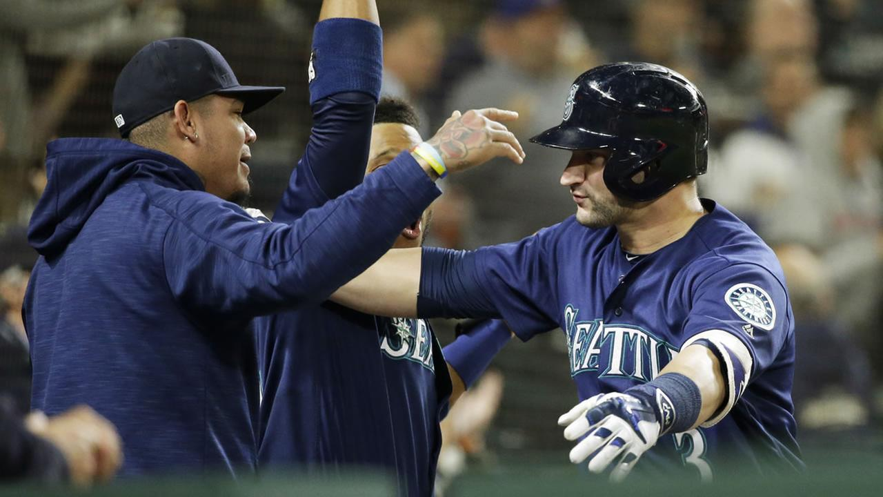 Mariners Mike Zunino celebrates a hit a go-ahead solo home run against the Athletics in the seventh inning of a baseball game, Thursday, Sept. 29, 2016, in Seattle. (AP Photo)