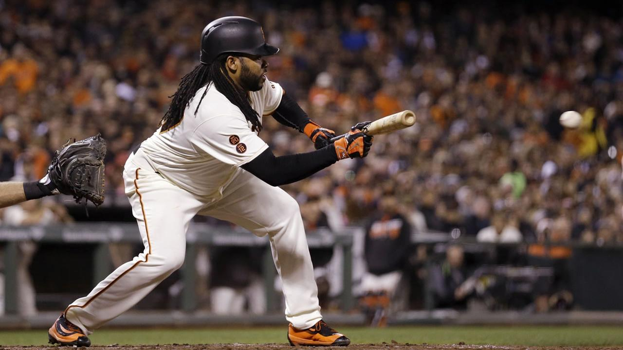 Giants Johnny Cueto bunts against the Colorado Rockies in the sixth inning of a baseball game Thursday, Sept. 29, 2016, in San Francisco. (AP Photo/Ben Margot)