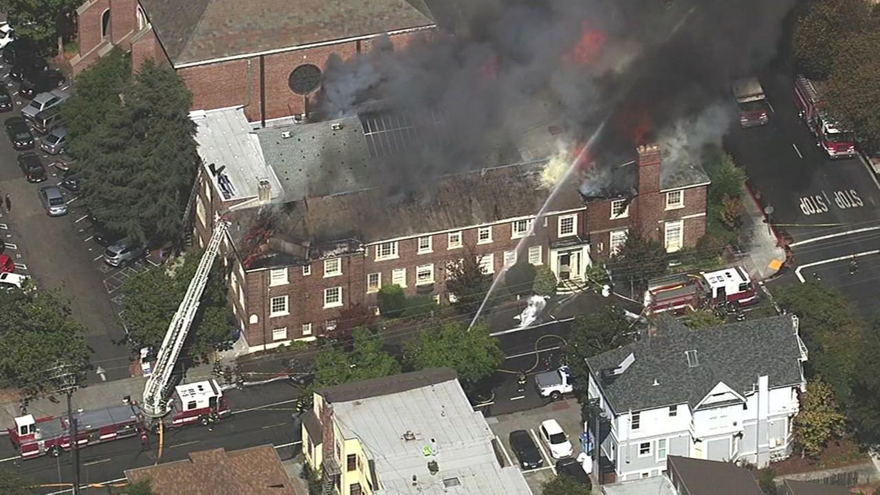Firefighters battle 4-alarm fire at church in Berkeley, California, Friday, September 30, 2016.