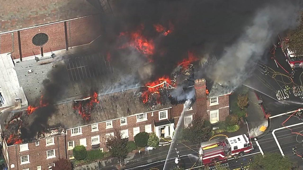 Firefighters battle a four-alarm blaze at a church on Channing Way and Dana Street in Berkeley, Calif. on Friday, September 30, 2016.KGO-TV