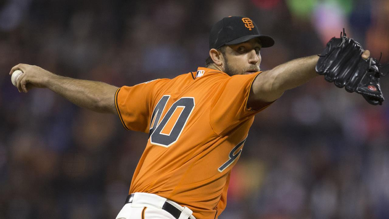 San Francisco Giants starting pitcher Madison Bumgarner delivers against the Los Angeles Dodgers during the first inning of a baseball game, Sept. 30, 2016, in San Francisco.