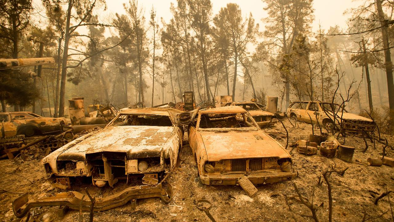 Vintage cars line a property after the Loma fire burned through Loma Chiquita Road near Morgan Hill, Calif., on Wednesday, Sept. 28, 2016.