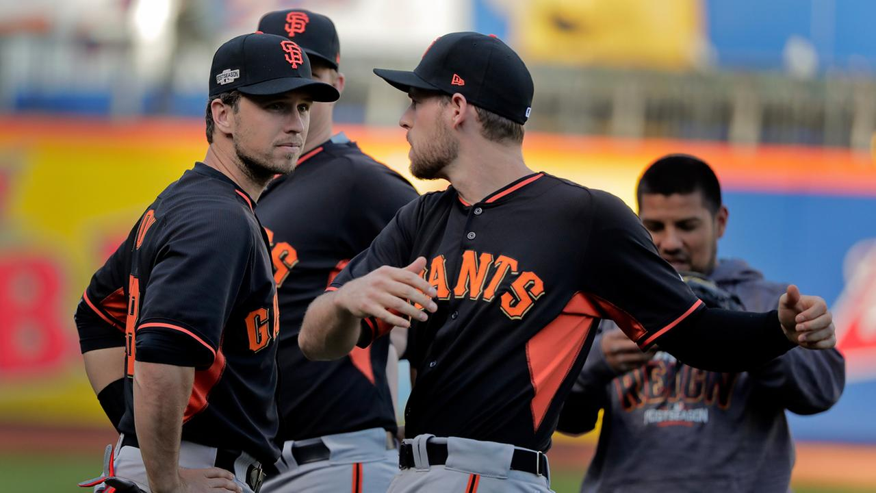 San Francisco Giants catcher Buster Posey, left, and third baseman Conor Gillaspie (21) talk while stretching during workout, Tuesday, Oct. 4, 2016, in New York.